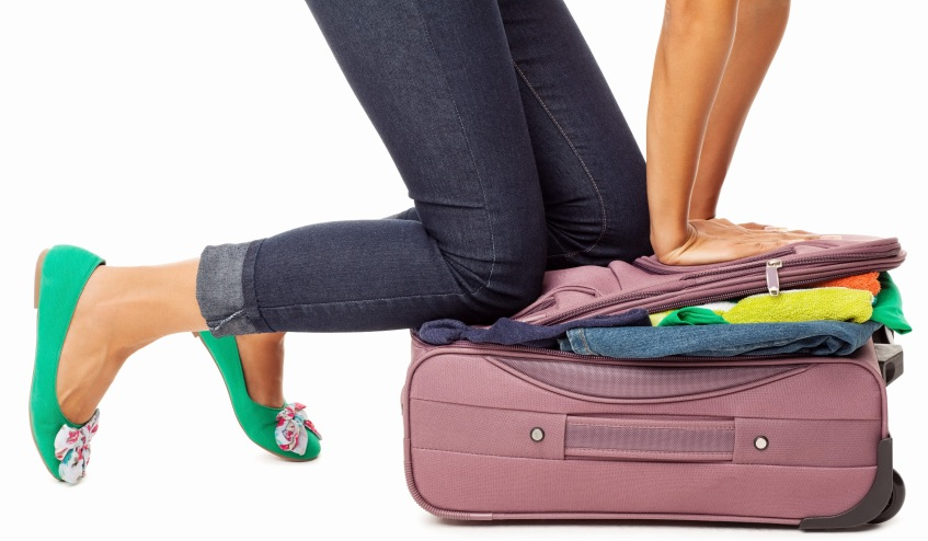 Woman Trying to Close Overfilled Suitcase | Teplis Travel