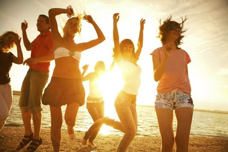Friends Dancing on the Beach | Teplis Travel
