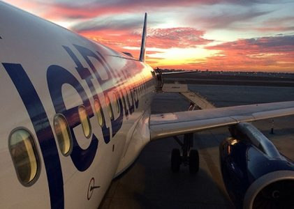 JetBlue Airplane at Sunset | Teplis Travel