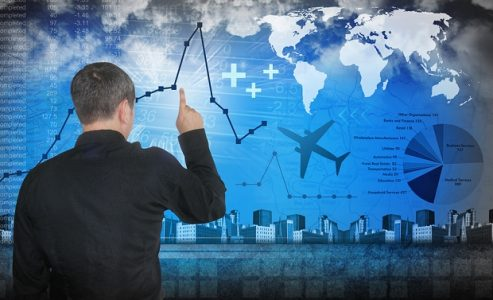 Man With Graph of Business Travel Spending | Teplis Travel