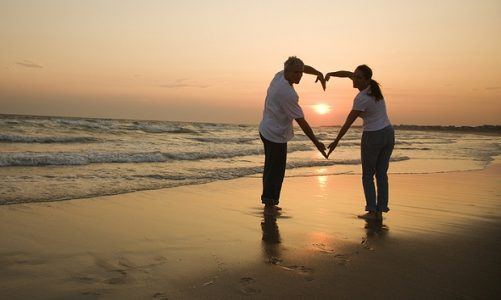 Couple on the Beach at Sunset | Teplis Travel