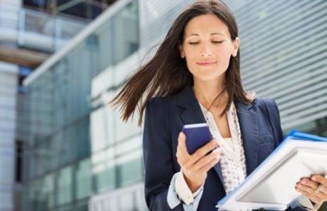 Business Woman Looking at Her Phone | Teplis Travel
