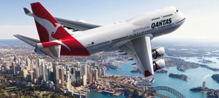 Qantas Airplane Flying Over City | Teplis Travel