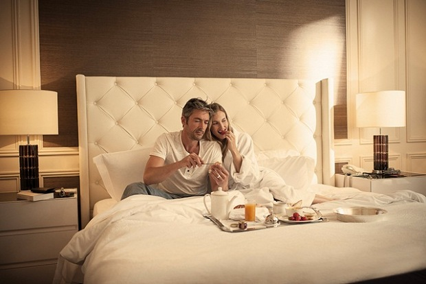 Man and Woman Having Breakfast in Bed | Teplis Travel