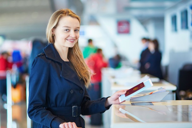 Woman at Airport Check-in Counter | Teplis Travel