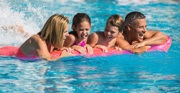 Family Having Fun At the Pool | Teplis Travel