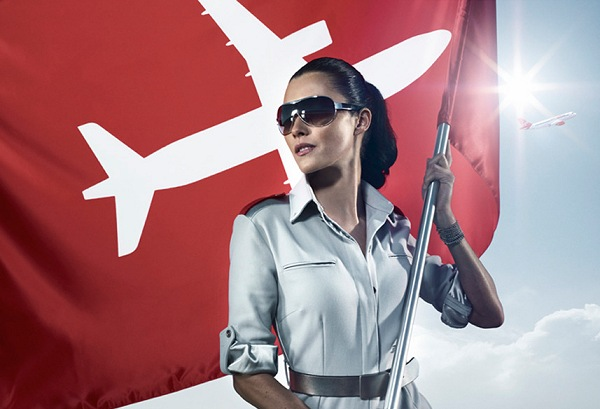Virgin America Model in Front of Company Flag | Teplis Travel
