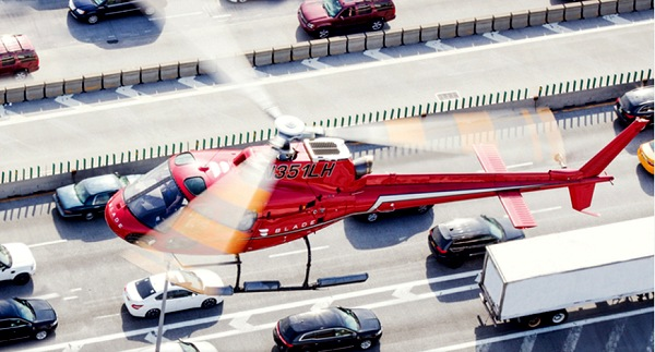 Top View of Helicopter Over Traffic | Teplis Travel