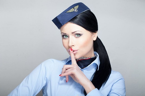 Flight Attendant Holding Finger to Her Lips | Teplis Travel