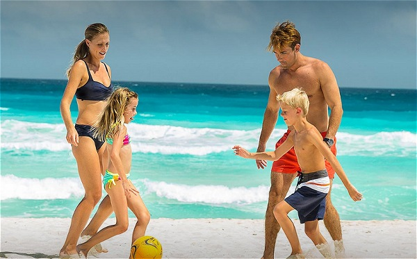 Family Playing Soccer at Beach | Teplis Travel