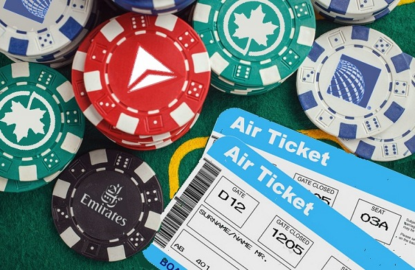 Airplane Tickets Next to United Emirates Poker Chip | Teplis Travel