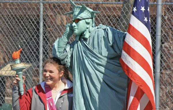 American Tourist Next to Fake Statue of Liberty | Teplis Travel