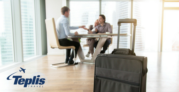 Corporate Travel Services Employer Communicating to Employee with Suitcase | Teplis Travel